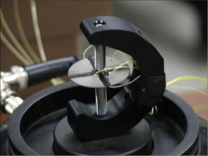 Four electrode piezoelectric disk transducer for vibration energy harvesting.