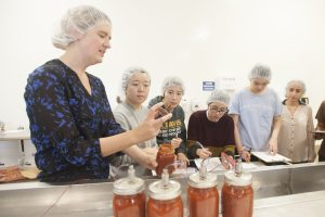 Professor Gail Bornhorst talks with students about what the tempurature measurements mean from the jars during the Food Science and Technology class in the Foot Processing Pilot Plant Class on November 2, 2016. The students checked tempurature of canned tomatoes, the proper metal can measurements for safety, and learn how retorts sterilize food after it is canned.